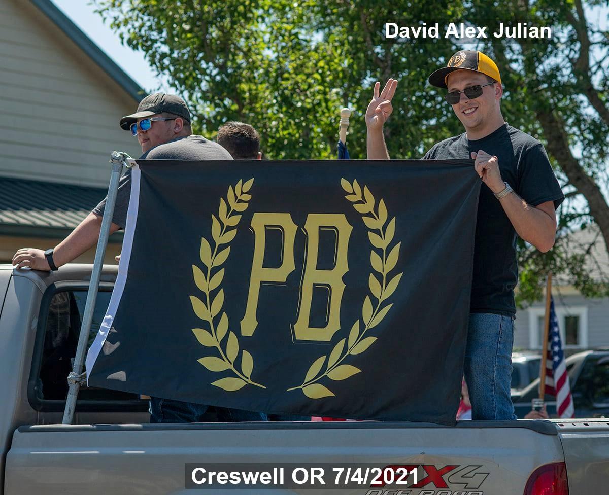 Proud Boy David Alex Julian displays a PB flag in Creswell on 7/4
