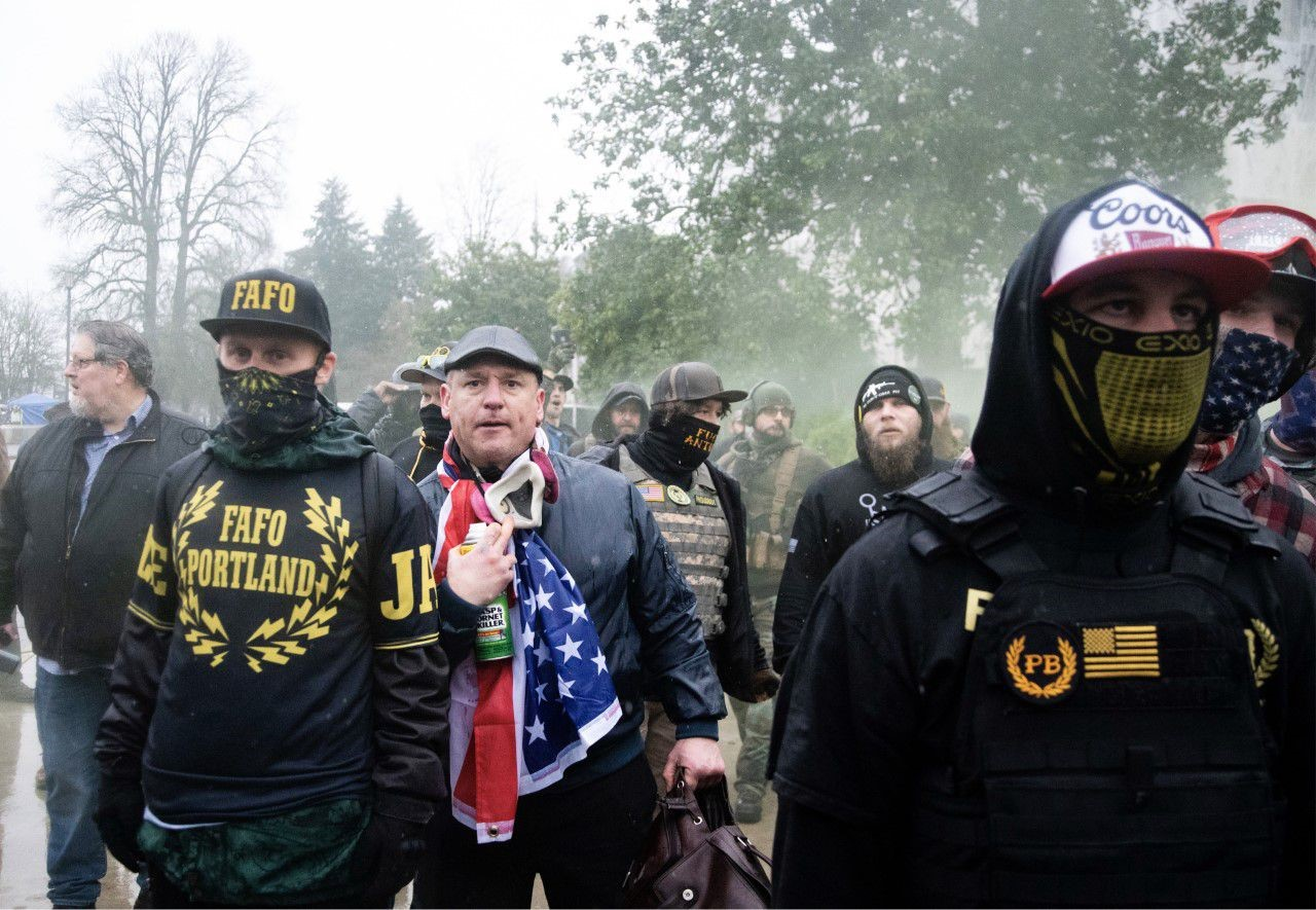 Members of the Proud Boys face off with antifascists alongside nazi murderer Kyle Brewster